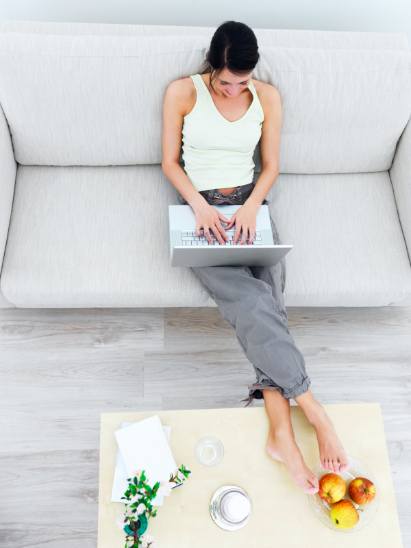 High angle view of a young woman using laptop