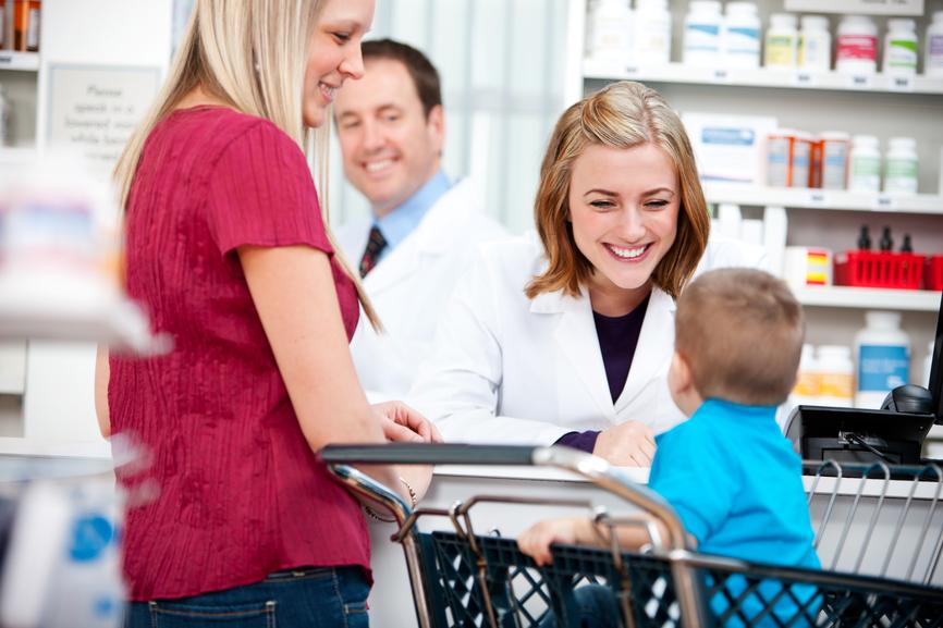 Pharmacy: Pharmacist Talking To Child in Shopping Cart