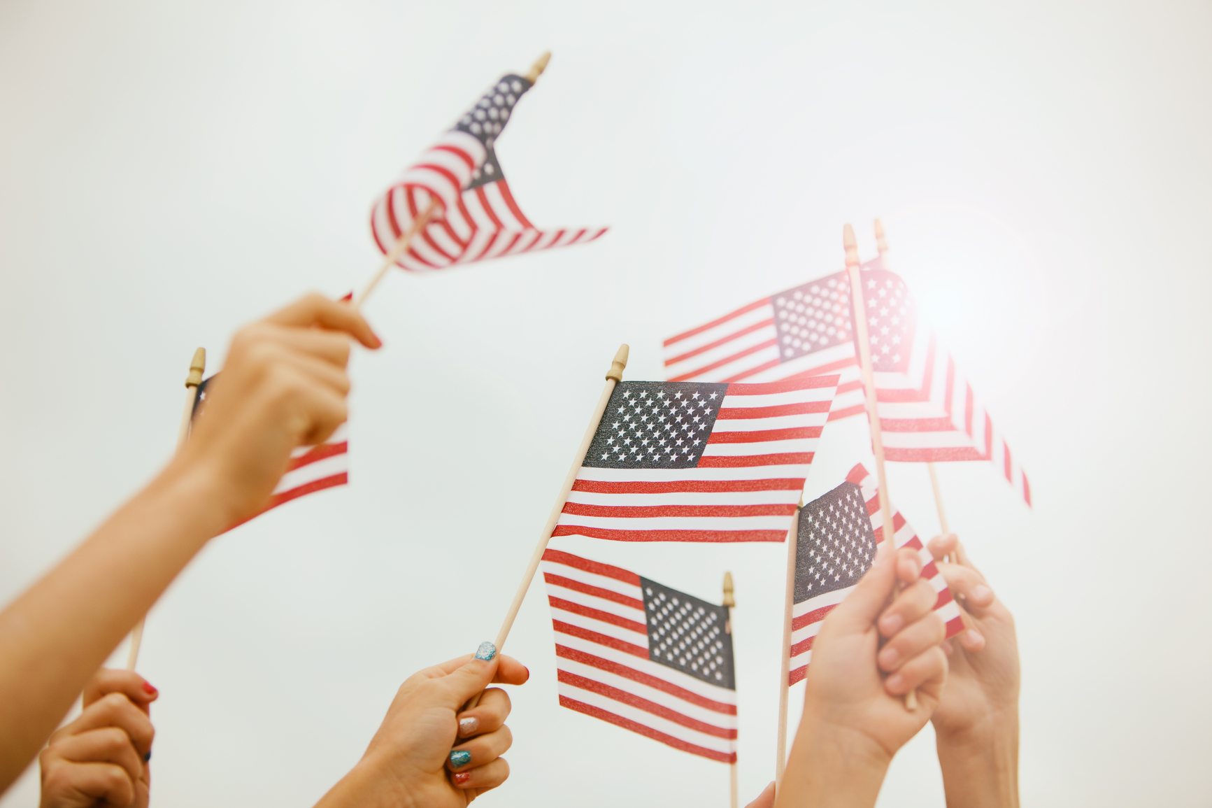Parade: Hands Waving American Flags In Sky