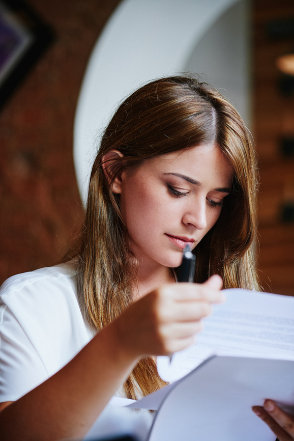 Client reading and signing legal document