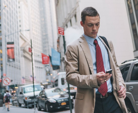 Young Professional Man in Suit Walking in New York's Wall Street
