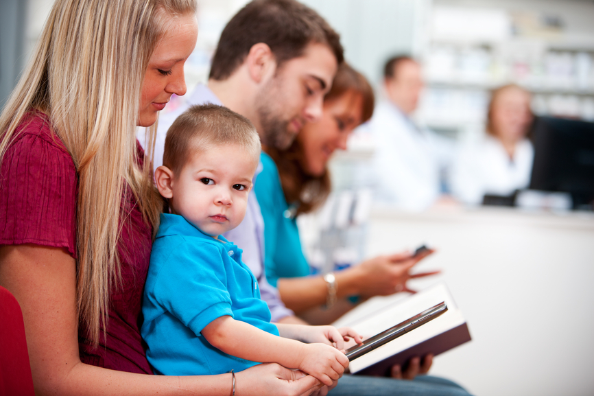 Pharmacy:Child Sitting in Mother's Lap at the Pharmacy