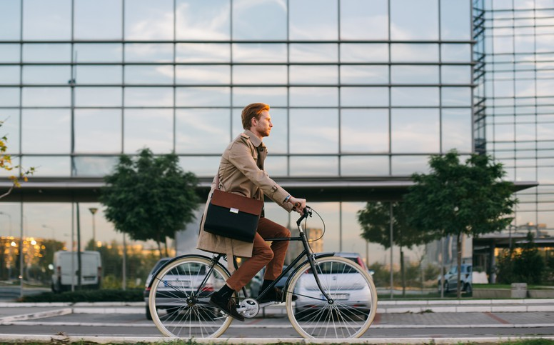 Businessman riding a bicycle on his way to work.