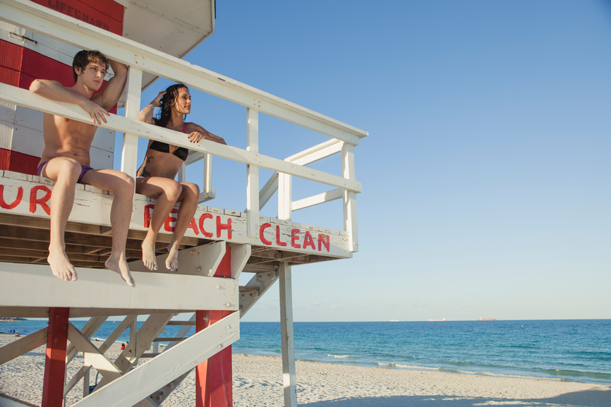 lovers hanging out in a lifeguard's hut