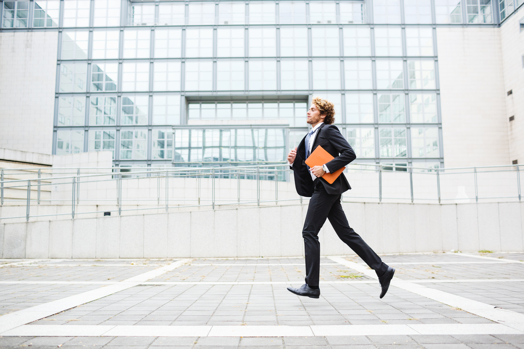 man running to file taxes