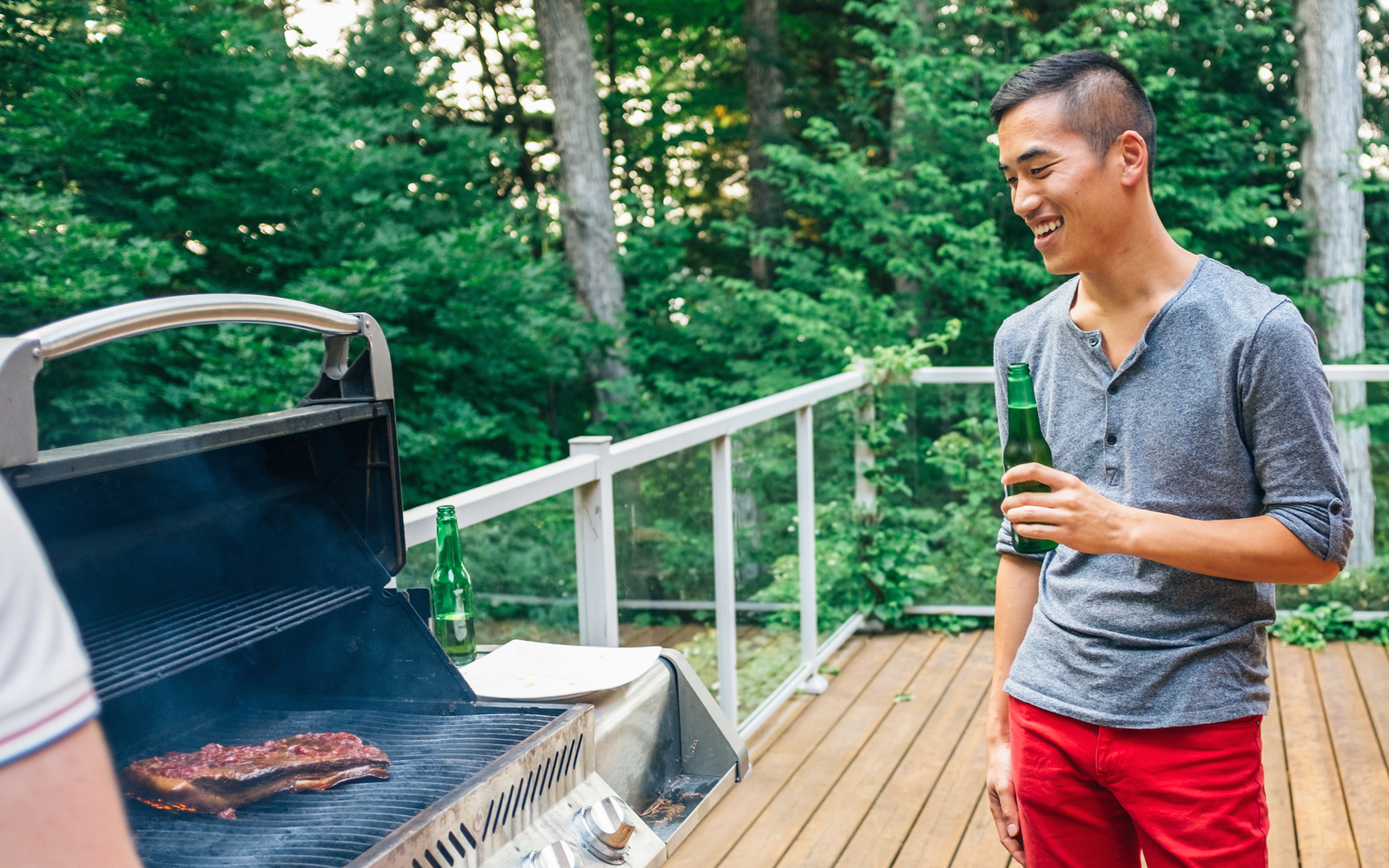 Grilling pork belly outdoors in summer