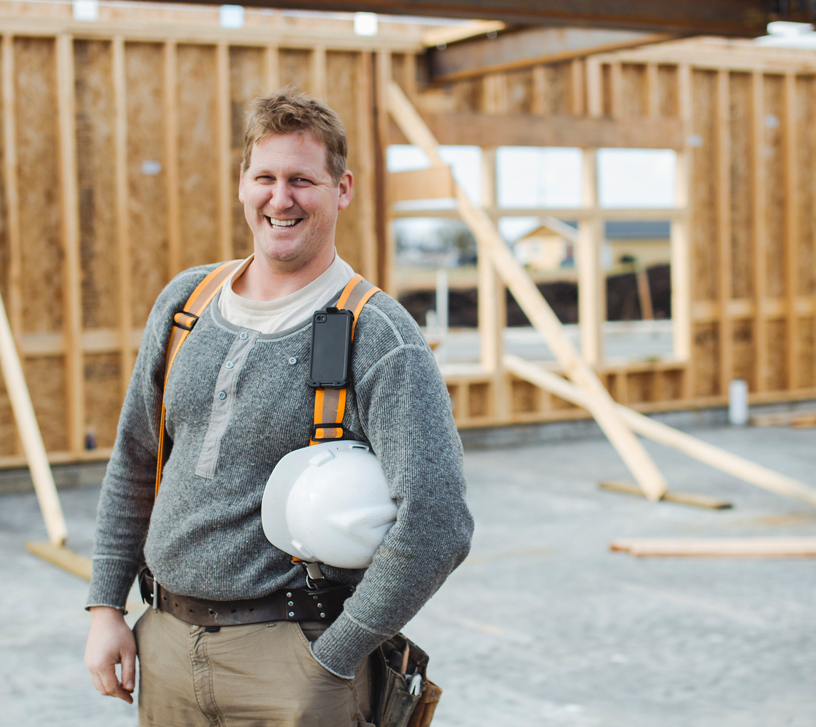 Portrait of smiling carpenter man at construction site